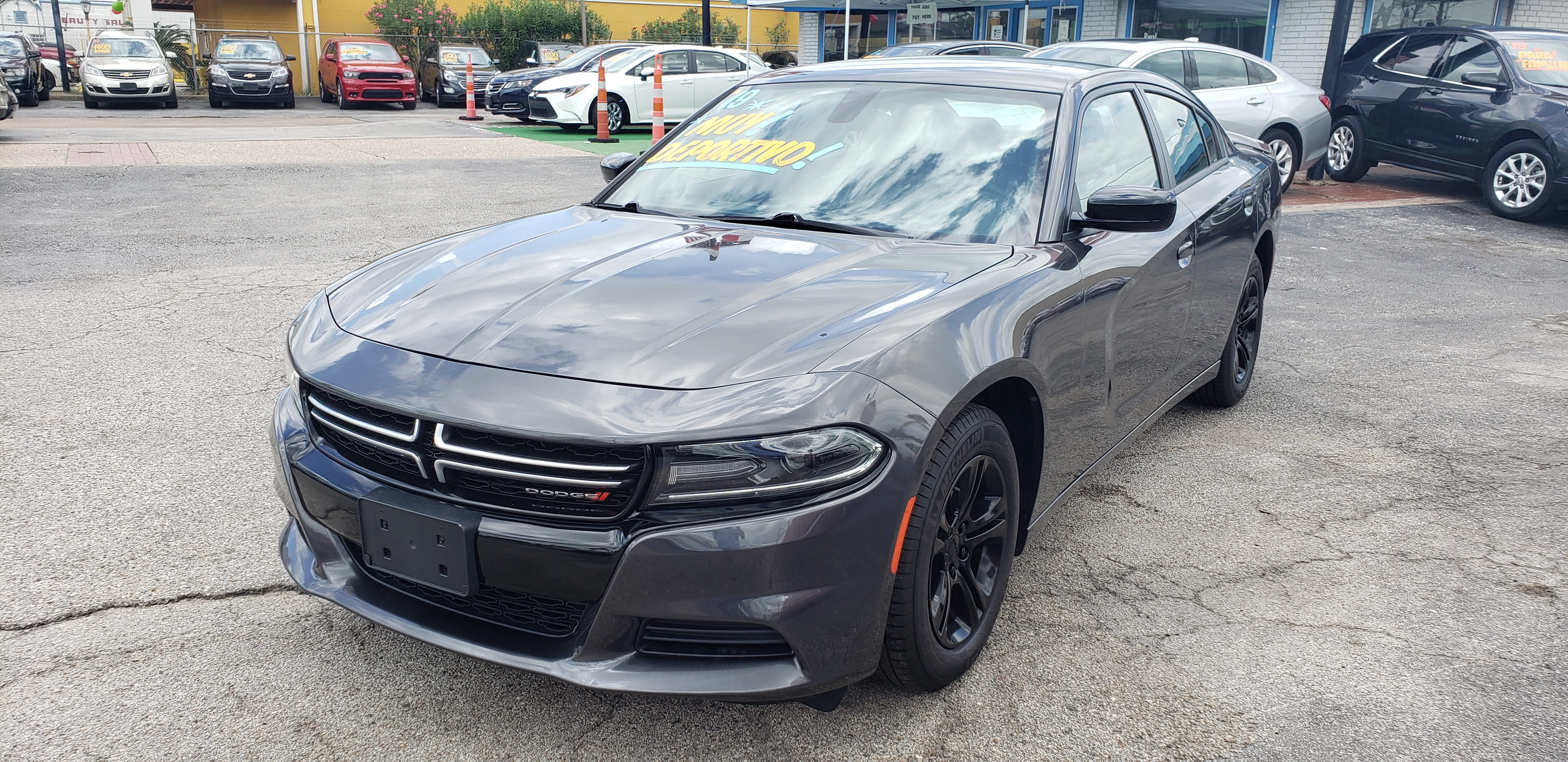 2019 Dodge Charger SXT (2C3CDXBG1KH) with an 3.6L V6 DOHC 24V engine, 8A transmission, located at 1842 Wirt Road, Houston, TX, 77055, (713) 973-3903, 29.805330, -95.484787 - Photo #0